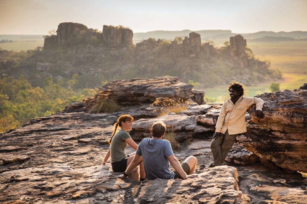 Visitors looking over the Kakadu landscape with an Aboriginal guide from Kakadu Cultural Tours at Cannon Hill. Picture: Supplied